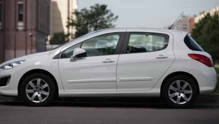 Car Peugeot 308 white color side view